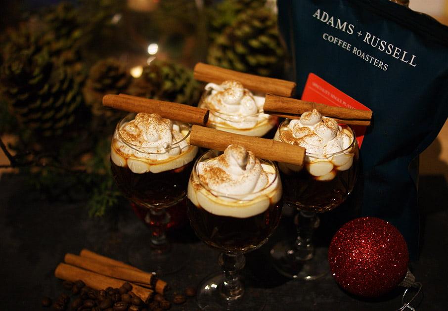 Christmas hot drinks with espresso, cinnamon cognac and meringue